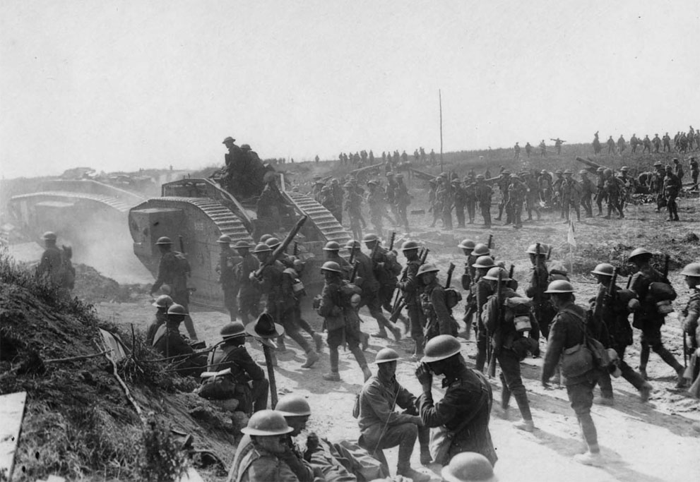 wwi-soldiers-marching-behind-single-tank